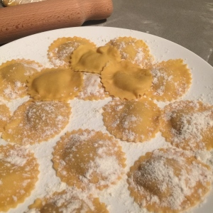 It is important to sprinkle the plate and then the ravioli with flour so they don't stick.